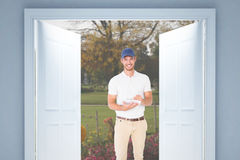 Composite image of happy delivery man with cardboard box and clipboard Royalty Free Stock Photography