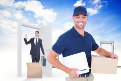 Composite image of happy delivery man with cardboard box and clipboard royalty free stock photo