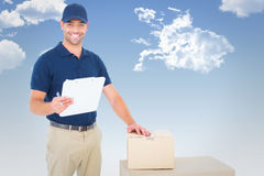 Composite image of happy delivery man with cardboard boxes and clipboard Royalty Free Stock Photos