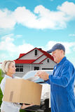 Composite image of happy delivery man with customer Stock Photography