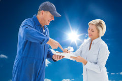 Composite image of happy delivery man with customer Stock Image
