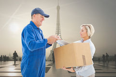 Composite image of happy delivery man with customer Royalty Free Stock Image