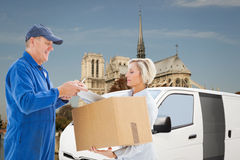 Composite image of happy delivery man with customer Royalty Free Stock Images