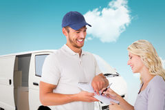 Composite image of happy delivery man getting signature from customer. Happy delivery men getting signature from customer against blue sky Royalty Free Stock Images