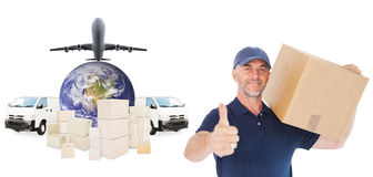 Composite image of happy delivery man holding cardboard box showing thumbs up. Happy delivery man holding cardboard box showing thumbs up against logistics Royalty Free Stock Image