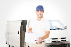 Composite image of happy delivery man holding clipboard Royalty Free Stock Photography