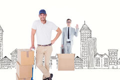 Composite image of happy delivery man leaning on trolley of boxes Stock Images