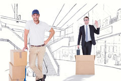 Composite image of happy delivery man leaning on trolley of boxes Royalty Free Stock Photos