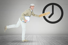 Composite image of happy delivery man running while holding parcel Stock Photos