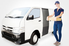 Composite image of happy delivery woman holding cardboard box Stock Image