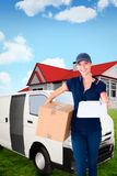Composite image of happy delivery woman holding cardboard box and clipboard Stock Photo