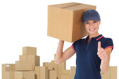 Composite image of happy delivery woman holding cardboard box showing thumbs up Stock Images