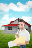 Composite image of happy derivery man giving envelop Royalty Free Stock Photo