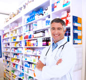 Composite image of happy doctor smiling at camera Royalty Free Stock Photo