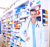 Composite image of happy doctor smiling at camera Royalty Free Stock Photos