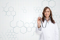 Composite image of happy doctor using stethoscope Stock Images