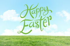Composite image of happy easter. Happy easter against field and sky Stock Image