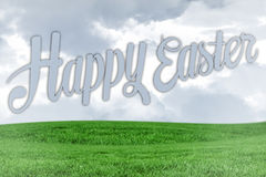 Composite image of happy easter. Happy easter against field and sky Stock Photos