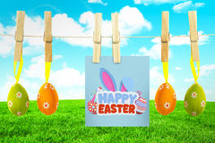 Composite image of happy easter. Happy easter against field and sky Royalty Free Stock Images