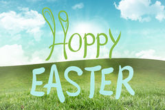 Composite image of happy easter graphic. Happy easter graphic against field and sky Royalty Free Stock Photo