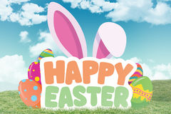 Composite image of happy easter graphic. Happy easter graphic against field and sky Stock Image