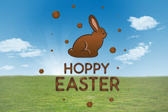 Composite image of happy easter graphic. Happy easter graphic against field and sky Stock Images