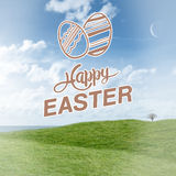Composite image of happy easter graphic. Happy easter graphic against field and sky Royalty Free Stock Image