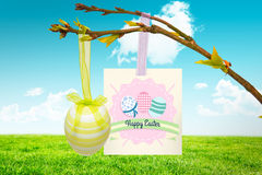 Composite image of happy easter graphic. Happy easter graphic against field and sky Stock Photography