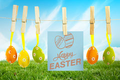 Composite image of happy easter graphic. Happy easter graphic against field and sky Stock Photos