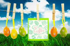 Composite image of happy easter graphic. Happy easter graphic against field and sky Royalty Free Stock Photography