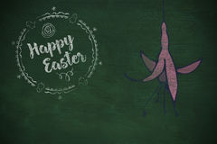 Composite image of happy easter white logo against a black background Stock Photo
