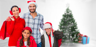Composite image of happy family looking at camera Stock Photography