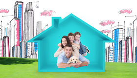Composite image of happy family lying on top of each other with dog Stock Image