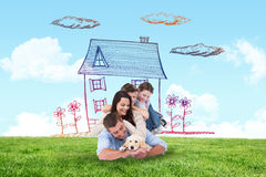 Composite image of happy family with puppy Stock Photography