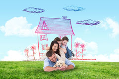 Composite image of happy family with puppy Royalty Free Stock Photography