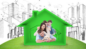 Composite image of happy family with puppy Royalty Free Stock Photo