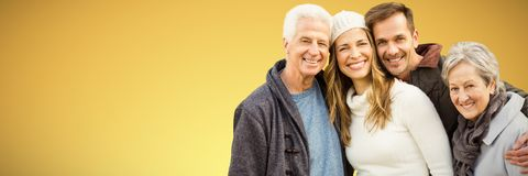 Composite image of happy family standing together and smiling. Happy family standing together and smiling against abstract yellow background royalty free stock photo