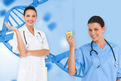 Composite image of happy female medical team Royalty Free Stock Photo