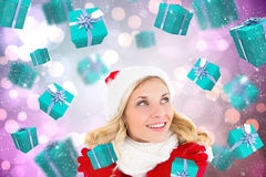 Composite image of happy festive blonde Royalty Free Stock Photography