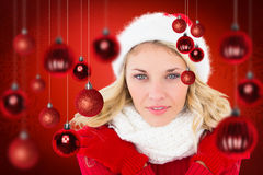 Composite image of happy festive blonde Stock Image