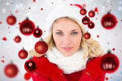 Composite image of happy festive blonde Royalty Free Stock Images