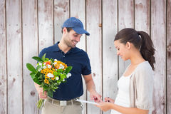 Composite image of happy flower delivery man with customer. Happy flower delivery men with customer against wooden planks stock image