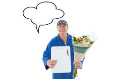 Composite image of happy flower delivery man showing clipboard Stock Image