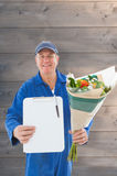 Composite image of happy flower delivery man showing clipboard Stock Images