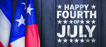 Composite image of happy fourth of july. Happy fourth of july against wood royalty free stock photo