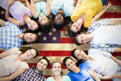 Composite image of happy friends lying in circle Royalty Free Stock Photos