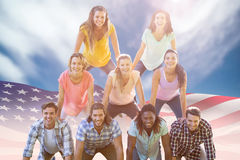 Composite image of happy friends making human pyramid Royalty Free Stock Image