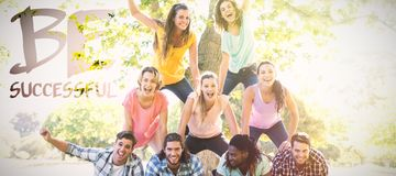 Composite image of happy friends in the park making human pyramid. Happy friends in the park making human pyramid against be sucessful royalty free stock photography