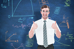 Composite image of happy geeky businessman with thumbs up Stock Image