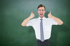 Composite image of happy geeky businessman with thumbs up Royalty Free Stock Photos
